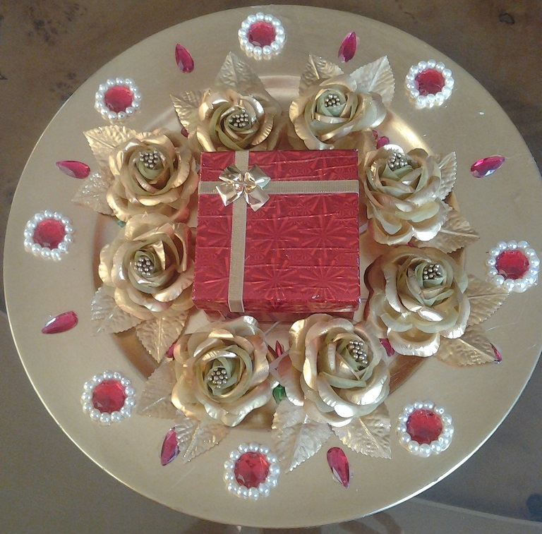Decorative gold tone tray to hold wedding rings