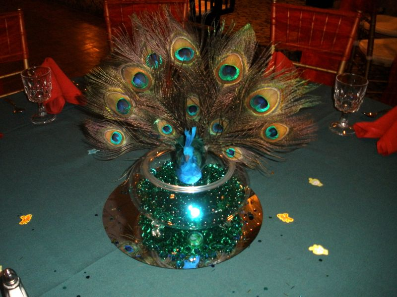 Peacock Centerpieces With Green And Red Settings Raji